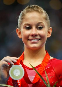 Silver medallist Shawn Johnson of the U.S. poses with her medal after the women's individual all-round gymnastics final at the Beijing 2008 Olympic Games August 15, 2008.     REUTERS/Mike Blake (CHINA) OLYMPICS-GYMNASTICS/